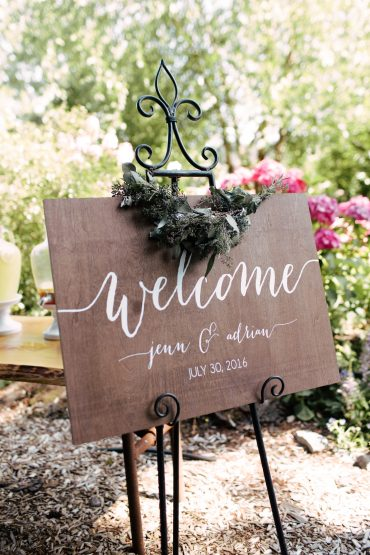 welcome sign with eucalyptus garland