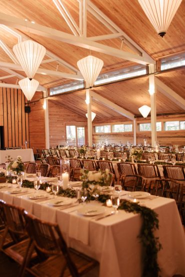 wedding dining tables with candles and eucalyptus runners