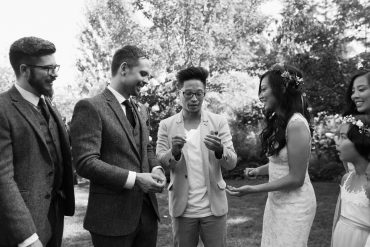 nash fung magician is great entertainment for guests at a fireseed catering wedding