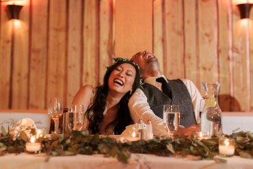 happy bride and groom at sweetheart table at fireseed catering wedding on whidbey island