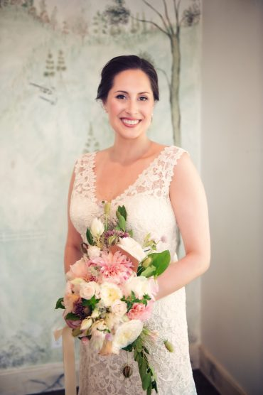 bride with pink and white bridal bouquet