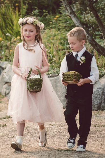 flower girl with flower crown and ringbearer with boutonniere