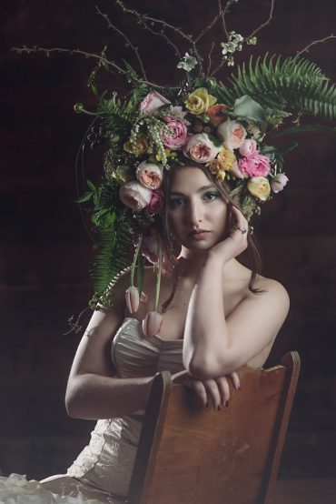 elaborate bohemian headdress with roses, tulips and fern