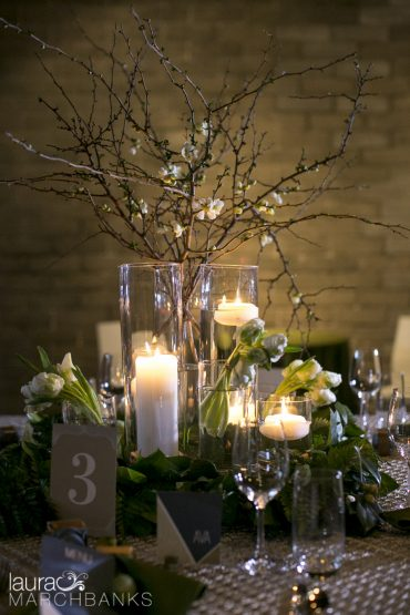 Centerpiece with candles and flowering branches | Tobey Nelson Events + Design | image by Laura Marchbanks