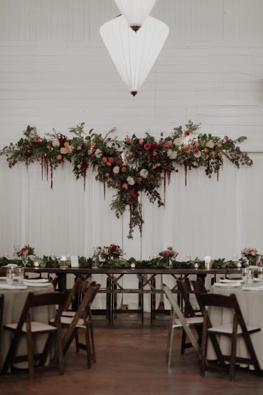 Whidbey Island Wedding | Floral backdrop for head table | Floral design by Tobey Nelson Events | venue Fireseed Catering | image by Malorie Kerouac