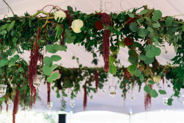 Floral chandelier detail with hanging amaranth