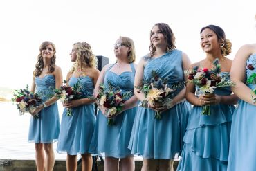bridesmaids in blue with bridal party flowers