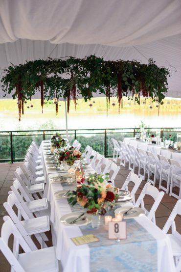 floral installation wedding reception with floral chandeliers