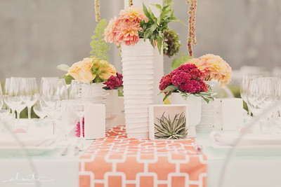 coral and white midcentury modern wedding table centerpiece