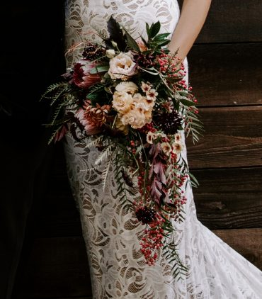 Boho chic cascade Bridal bouquet with Protea, Pepperberry, Apricot Lisianthus, Caramel Phlox | Seattle wedding flowers by Tobey Nelson Events | all locally grown and foam-free