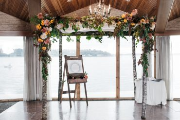 Autumn wedding arbor wedding chuppah at Edgewater Hotel for Seattle wedding flowers by Tobey Nelson Events and Design