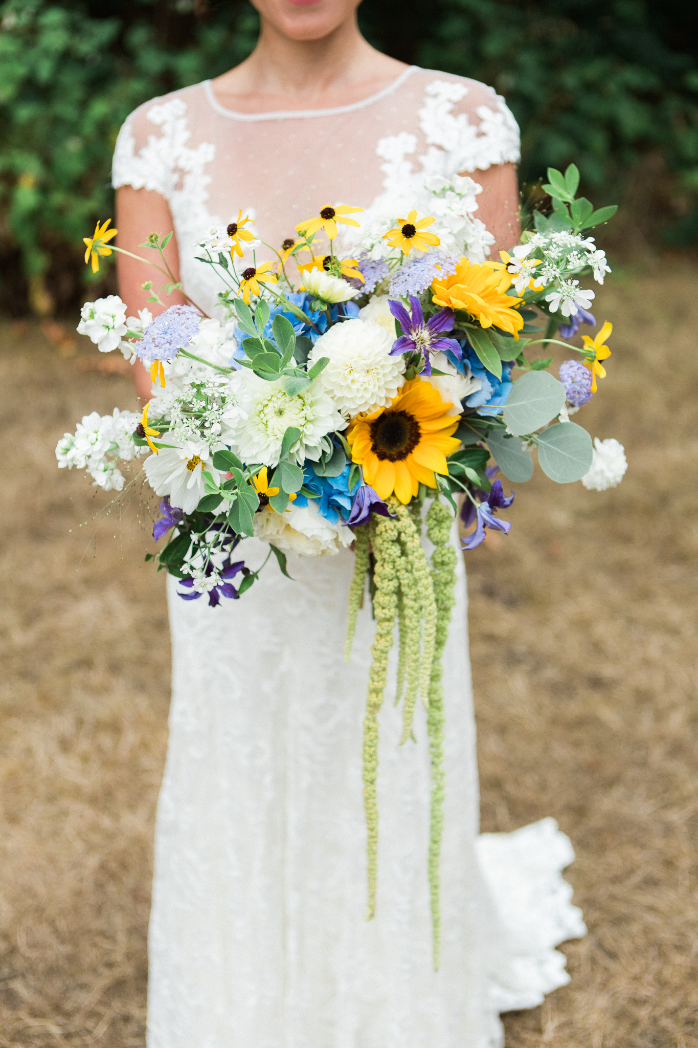 Sunflower bridal bouquet by tobey nelson eents design image by summer wedding flowers include locally grown sunflowers hydrangea and dahlia junglespirit Images