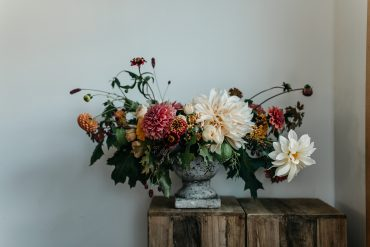 Compote centerpiece with locally grown Cafe Au Lait Dahlias and other summer blooms | Tobey Nelson Events + Design | Photo by Jess Hunter