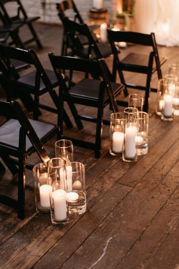 Same sex wedding aisle decoration with candles