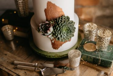 Cake by Baked with copper foil and succulent accents