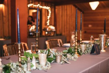 Long table with greenery runner and taper candles | Event design and wedding flowers by Tobey Nelson