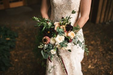 Bridal bouquet with locally grown summer flowers including Zinnia, Dahlia, Scabiosa and greenery | Tobey Nelson Events + Design | Image by The Manchiks