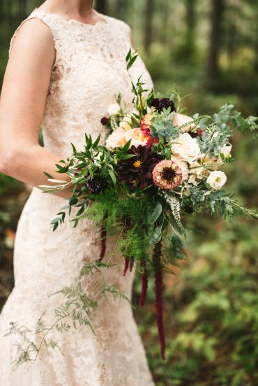 Blush & wine Bridal bouquet for Whidbey Island wedding. Flowers include Roses, Dahlias, Queen Red Lime Zinnias, with ferns, greenery and trailing Amaranth | Tobey Nelson Events + Design | Image by The Manchiks