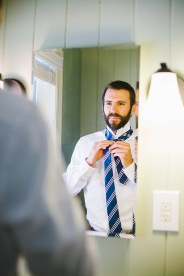 Groom getting ready for Whidbey Island Wedding