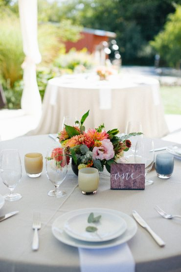 glassy babies and sunset colored flowers for wedding reception