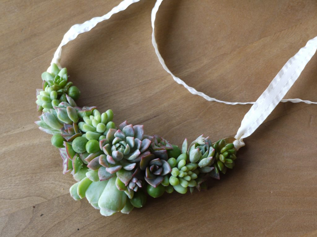 Living jewelry flower necklace with Succulents by Tobey Nelson