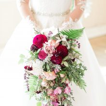Cascade bridal bouquet in plum and lavender with Roses, Dahlias and Ferns