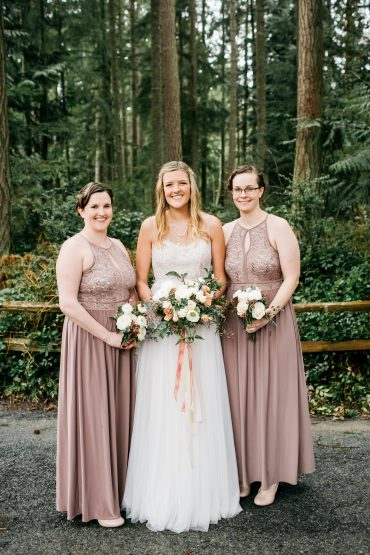 Bridesmaids in blush gowns with spring wedding flowers
