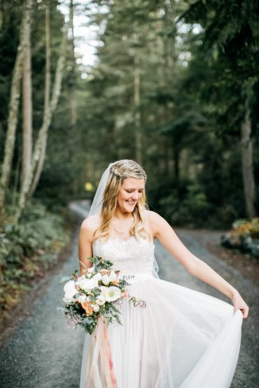 Beautiful spring bride with her white and blush wedding flowers