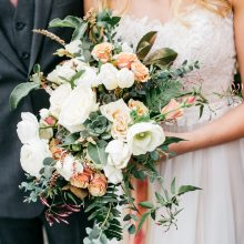 White, blush, and grey wedding bouquet with Anemone, Ranunculus, Rose, Tulip, Sedums, Eucalyptus, Jasmine vine and trailing silk ribbons