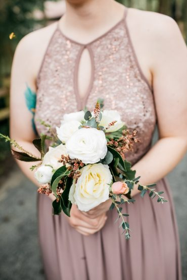 Simple bridesmaid bouquet in white and blush with Roses and Ranunculus