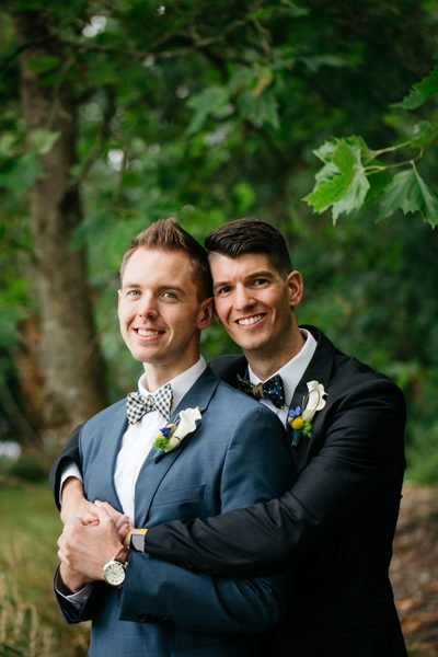 Seattle wedding flowers by Tobey Nelson | boutonnieres with Calla Lily and Billy Balls