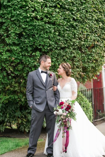The happy couple with their Woodinville Wedding flowers by Tobey Nelson