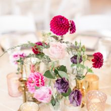 Collage centerpiece with Dahlias, Lisianthus and Roses in mercury glass and brass
