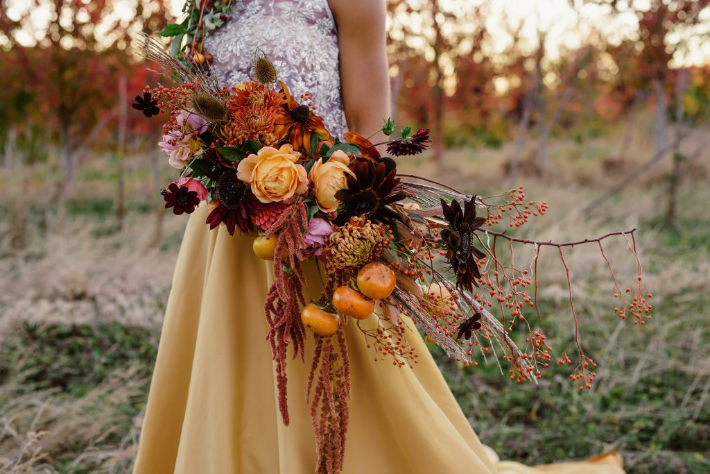 Autumn Bridal Bouquet with Persimmon and Rosehips by Tobey Nelson Events