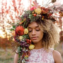 Botanical headpiece with flowers and fruit | floral couture by Tobey Nelson | image by Suzanne Rothmeyer