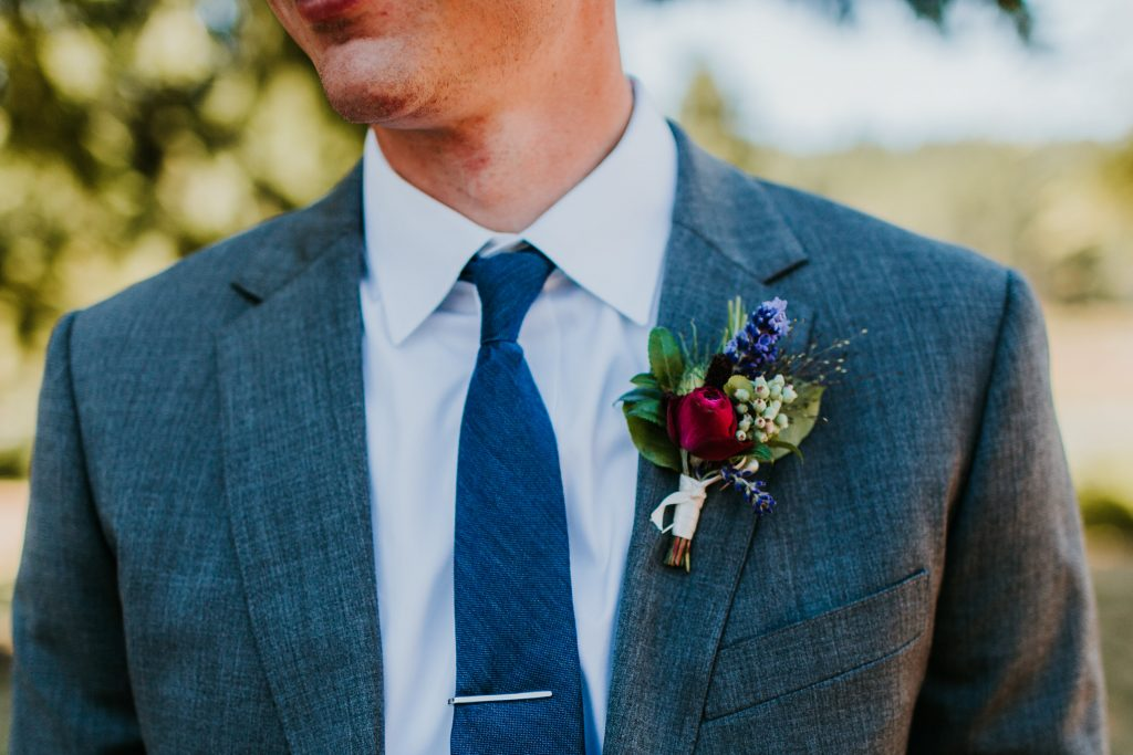Summer wedding boutonniere with Rose, Lavender and Huckleberry by Tobey Nelson Events