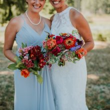Colorful jewel toned wedding flowers by Tobey Nelson Events