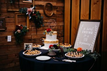 Cake table details with frames and floral accents by Tobey Nelson Events at Fireseed Catering on Whidbey Island