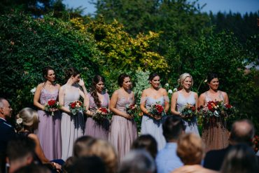 Summer bridesmaid bouquets with Dahlias, Roses, Zinnias and garden flowers by Tobey Nelson Events