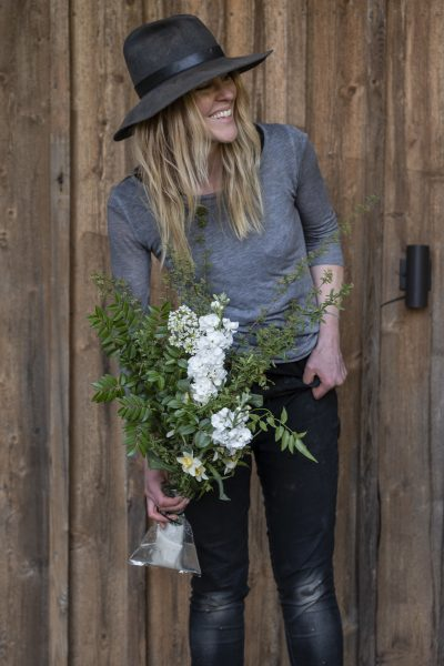Carly Jenkins from Killing Frost Farm shows blooms in Eco Fresh Bouquet Wraps ready for the large scale installation