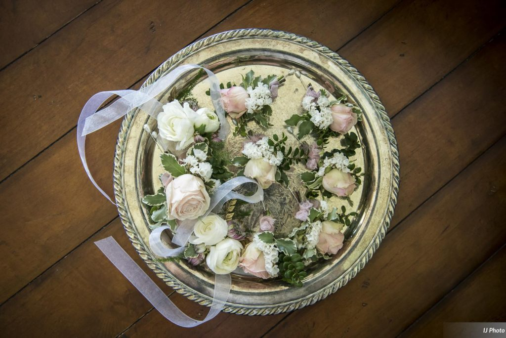 Boutonnieres and corsages in blush and white