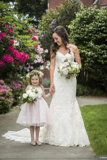 Bride and flower girl with spring wedding flowers