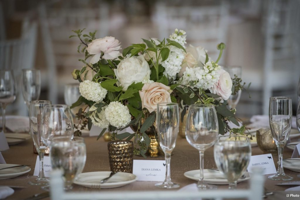 Wedding centerpiece in blush and white with Roses, Ranunculus and Peonies