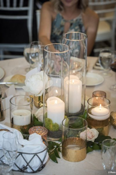 Candle collage centerpieces at Woodmark Hotel Tented Wedding
