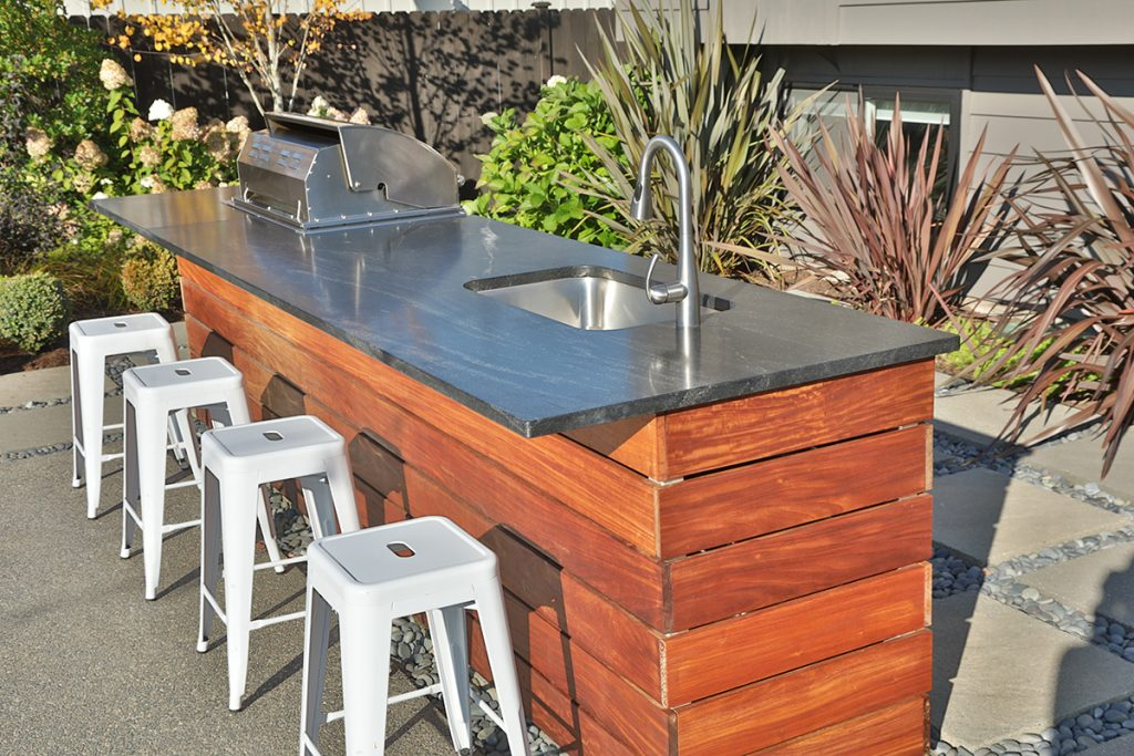 Outdoor kitchens bring a heartbeat to a backyard garden | Tobey Nelson Events