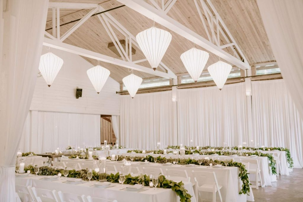 Greenery runners with candlelight for a White Wedding at Fireseed Catering | wedding flowers by Tobey Nelson Events | image by Kristen Marie Parker