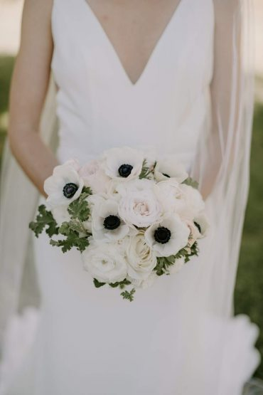 Classic, sophisticated Bridal bouquet with Panda Anemone and Garden Roses by Tobey Nelson Events. Wedding at Fireseed Catering