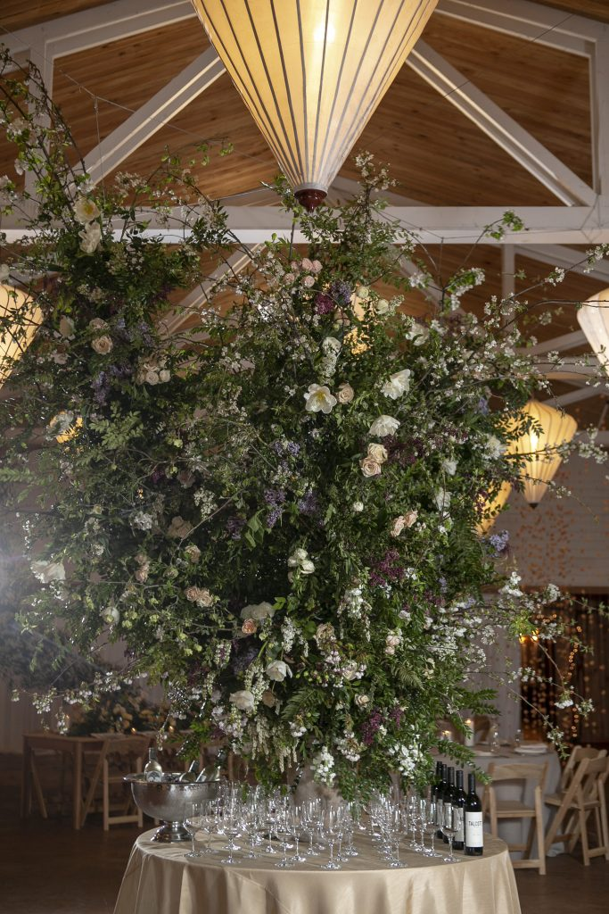 Make a statement at your event! Greet your guests with a large-scale foam-free floral installation at the bar