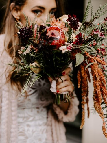 Seattle wedding flowers by Tobey Nelson Events | Boho Cascade Bridal Bouquet with Protea, Amaranth, copper Mums, peachy Lisianthus and greenery | image by Ronny & Rene