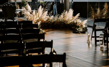 Seattle wedding ceremony at Olympic Pavilion | Ceremony decor with Pampas grass and greenery ring by Tobey Nelson Events | image by Ronny & Rene